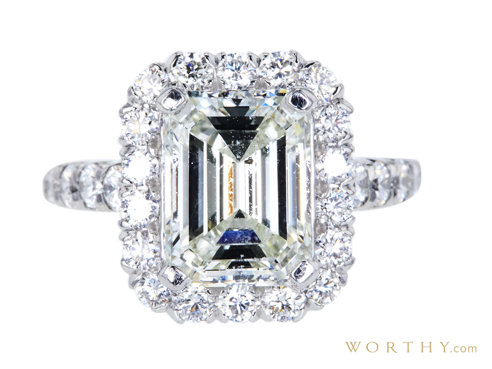 6215997c259f95 GIA 4.01 CT Emerald Cut Halo Ring Sold at Auction for $14083